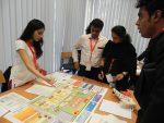 Students involed in a business simulation game at the DHBW University