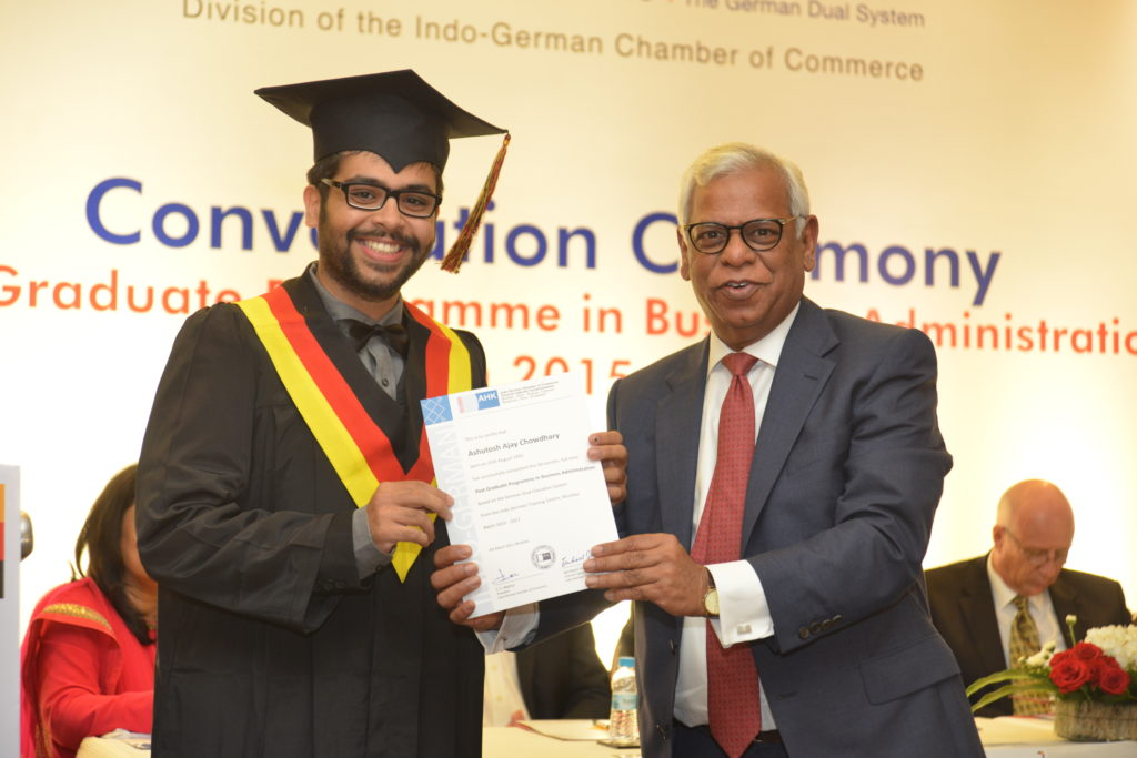 16 (5)Ashutosh Chowdhary, from PGPBA Batch 2015-2017, recruited by Bajaj Allianz General Insurance Co. Ltd. receives his certificate from C.S. Mathur, President IGCC