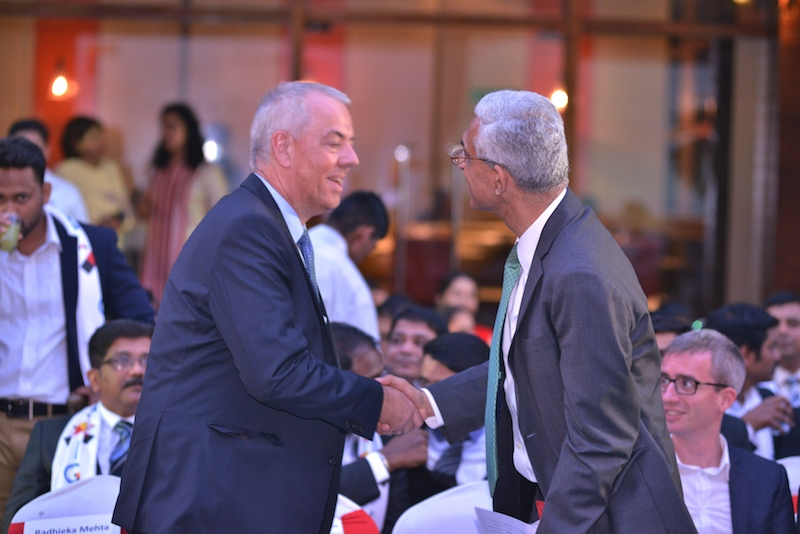 Dr. Andreas Lauermann, President and Managing Director, Volkswagen India greets Ravi Kirpalani, Managing Director and CEO, Thyssenkrupp India.