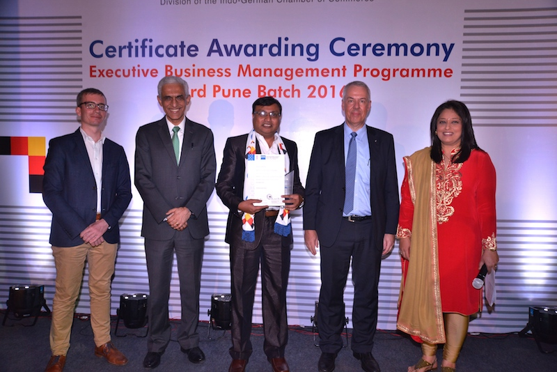 Dharmaraj Sawane, Asst. General Manager, Vulkan Technologies Pvt. Ltd., receives his certificate from Frank Hoffmann, Regional Director, Indo German Chamber of Commerce, Pune, Ravi Kirpalani, Managing Director and CEO, ThyssenKrupp India Pvt. Ltd., Andreas Lauermann, President and CEO, Volkswagen India Pvt. Ltd. and Radhieka Mehta, Director, Indo German Training Centre.