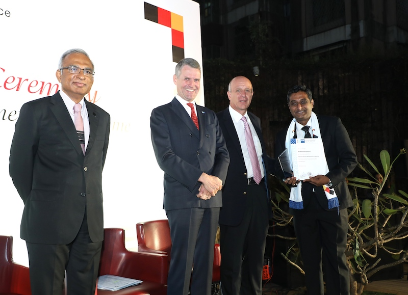 Venkatanarayanan S., General Manager, Mercedes-Benz India Pvt. Ltd. receives is certificate from Dr. Juergen Morhard, Consul General, German Consulate General in Mumbai